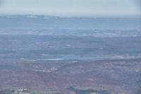 Le Lac Montbel, au loin, le Pic de Nore enneige