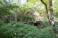 Le petit pont de bois sur la Trujol en dessous de Ste Foy de Peyrolieres